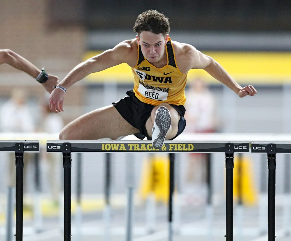 Iowa's Gratt Reed runs the men's 60 meter hurdles premier preliminary event during the Larry Wieczorek Invitational at the Recreation Building in Iowa City on Saturday, January 18, 2020. (Stephen Mally/hawkeyesports.com)