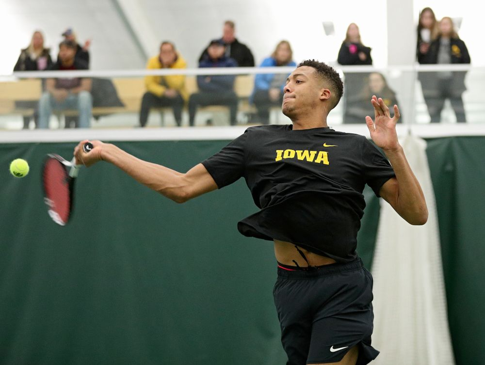 Iowa's Oliver Okonkwo returns a shot during his doubles match at the Hawkeye Tennis and Recreation Complex in Iowa City on Thursday, January 16, 2020. (Stephen Mally/hawkeyesports.com)