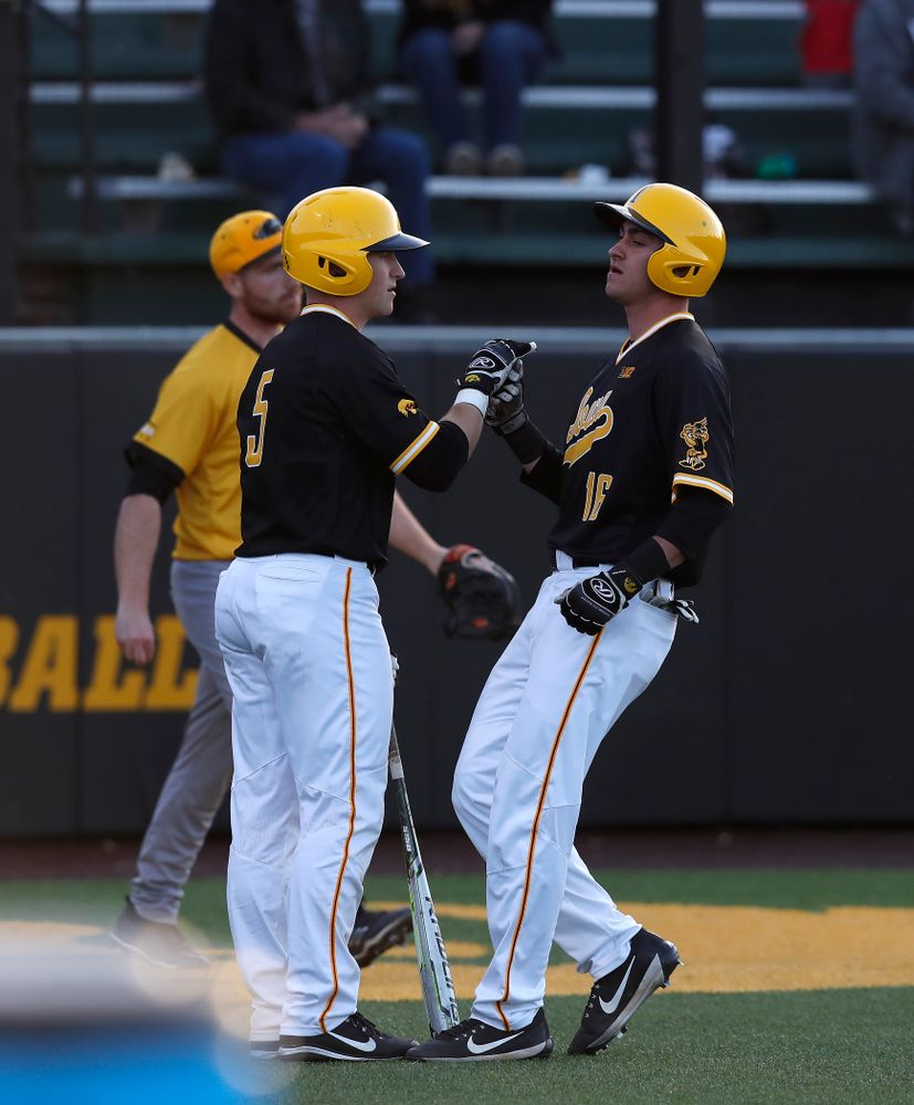 Iowa Hawkeyes catcher Tyler Cropley (5) and infielder Tanner Wetrich (16) against Milwaukee Wednesday, April 25, 2018 at Duane Banks Field. (Brian Ray/hawkeyesports.com)