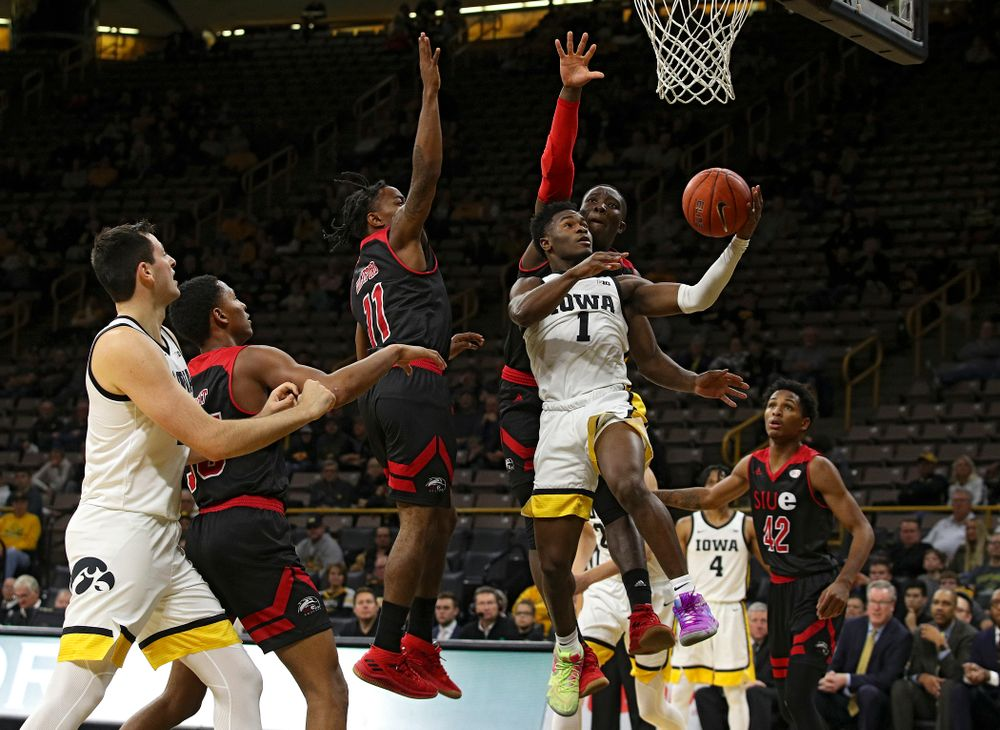 Iowa Hawkeyes guard Joe Toussaint (1) puts up a shot during the second half of their game at Carver-Hawkeye Arena in Iowa City on Friday, Nov 8, 2019. (Stephen Mally/hawkeyesports.com)