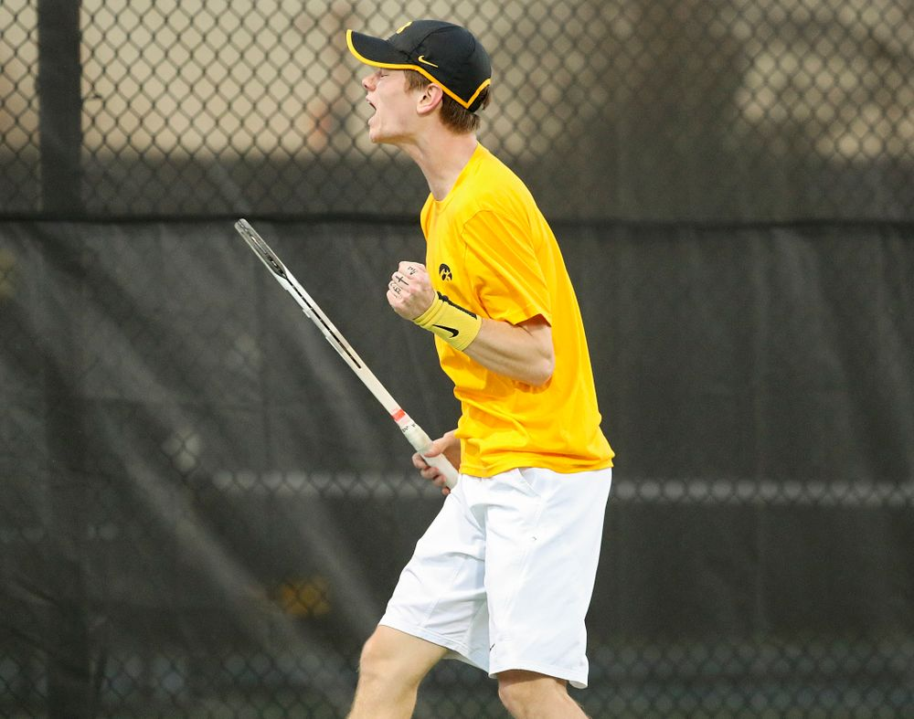 Iowa's Jason Kerst celebrates a point during his match again Michigan State at the Hawkeye Tennis and Recreation Complex in Iowa City on Friday, Apr. 19, 2019. (Stephen Mally/hawkeyesports.com)