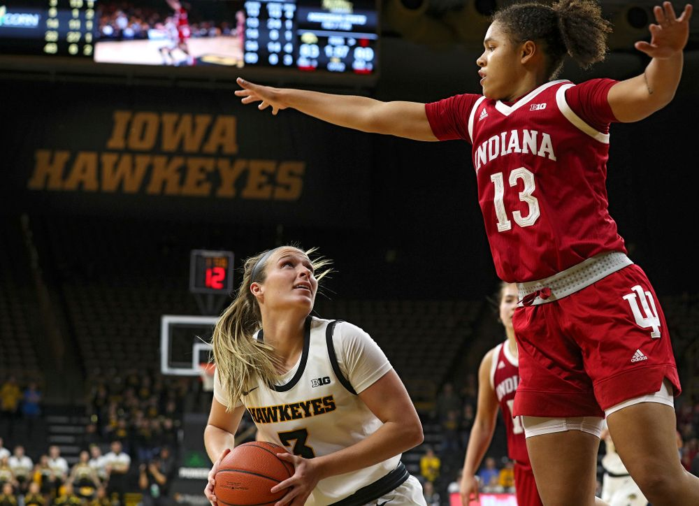 Iowa Hawkeyes guard Makenzie Meyer (3) waits for Indiana Hoosiers guard Jaelynn Penn (13) to clear before making a basket during the second overtime period of their game at Carver-Hawkeye Arena in Iowa City on Sunday, January 12, 2020. (Stephen Mally/hawkeyesports.com)