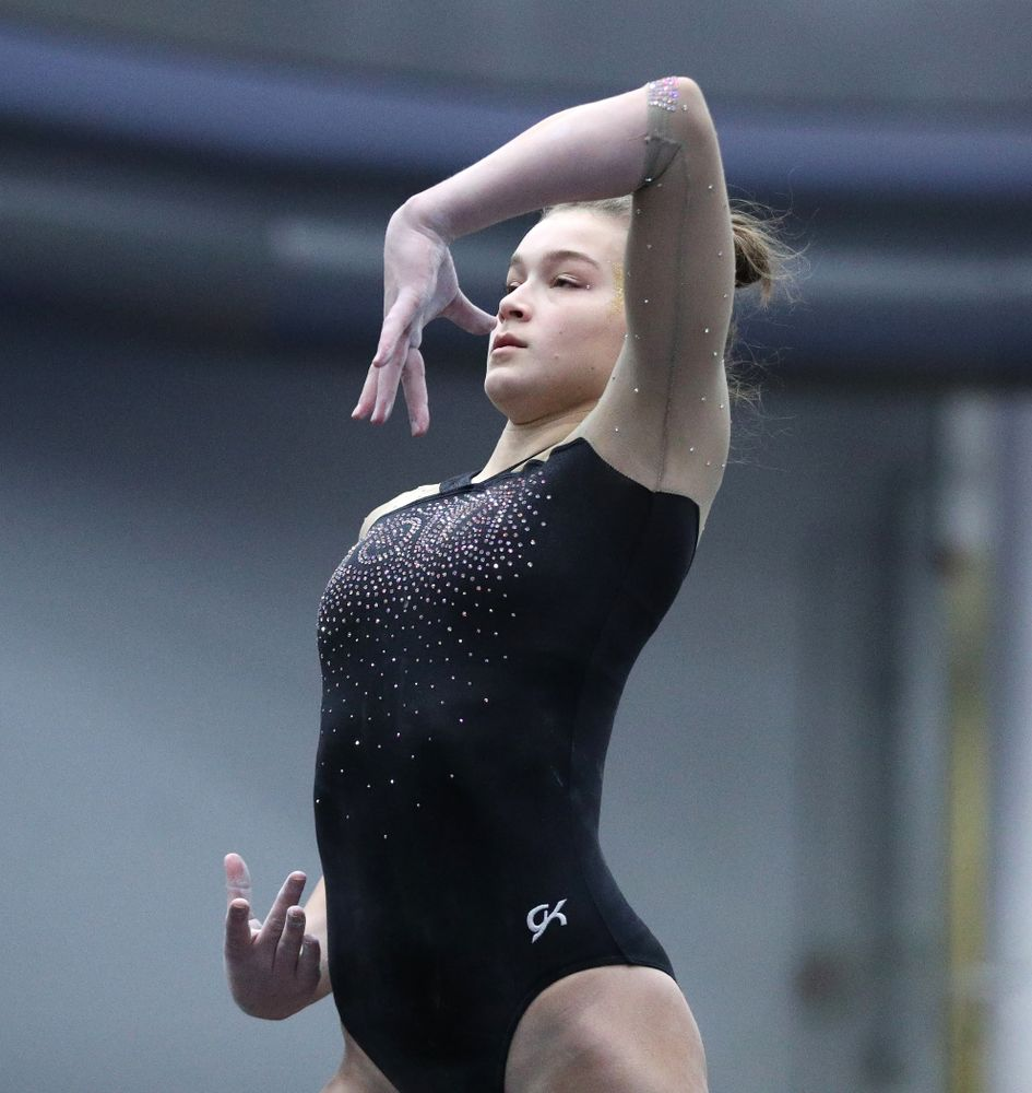 Mackenzie Vance competes on the floor during the Black and Gold intrasquad meet Saturday, December 1, 2018 at the University of Iowa Field House. (Brian Ray/hawkeyesports.com)