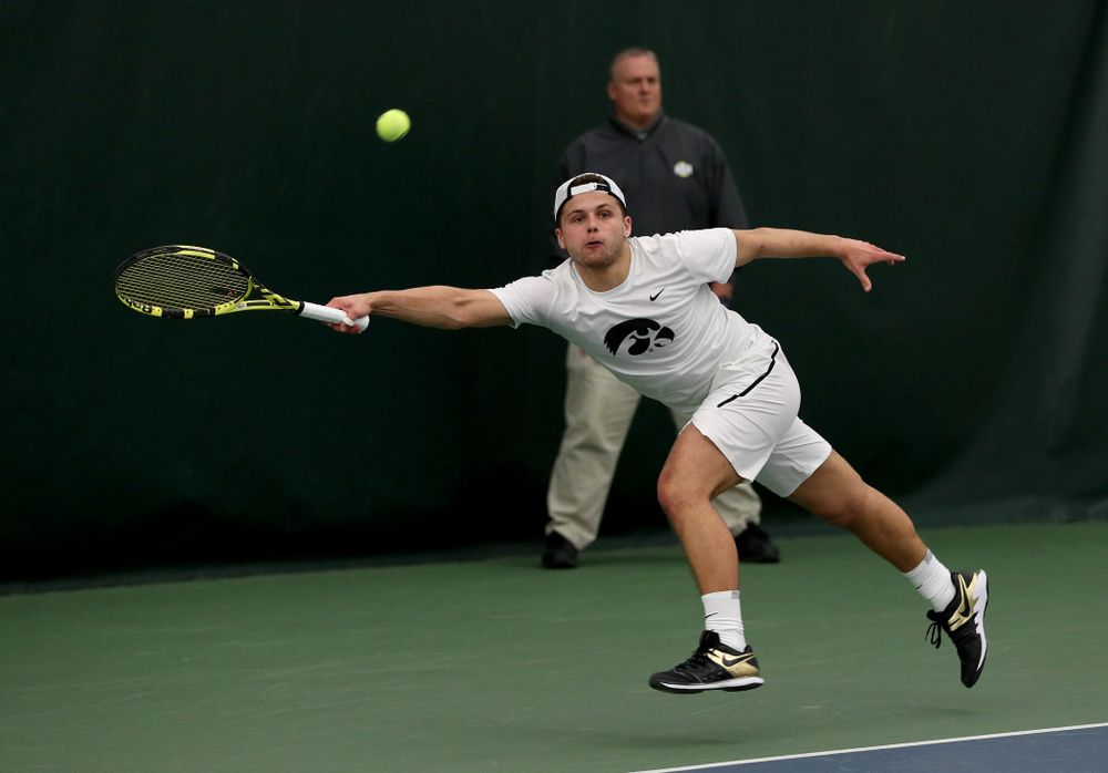 Iowa's Will Davies against Cornell Sunday, March 8, 2020 at the Hawkeye Tennis and Recreation Center. (Brian Ray/hawkeyesports.com)