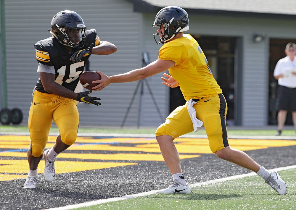 Iowa Hawkeyes running back Tyler Goodson (15) takes a handoff from quarterback Peyton Mansell (2) during Fall Camp Practice No. 11 at the Hansen Football Performance Center in Iowa City on Wednesday, Aug 14, 2019. (Stephen Mally/hawkeyesports.com)