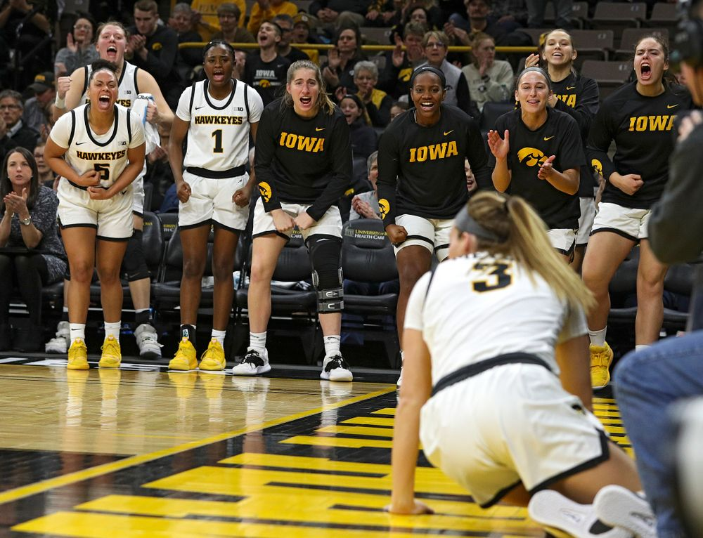 The Iowa bench reacts after Iowa Hawkeyes guard Makenzie Meyer (3) made a basket while being fouled during the third quarter of their game at Carver-Hawkeye Arena in Iowa City on Sunday, January 12, 2020. (Stephen Mally/hawkeyesports.com)