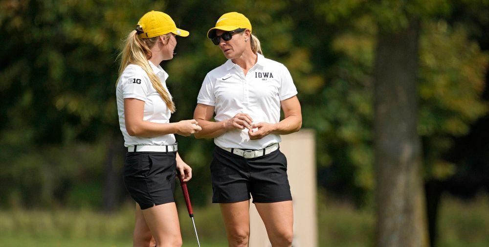 Iowa's Morgan Goldstein (from left) talks with head coach Megan Menzel during their dual against Northern Iowa at Pheasant Ridge Golf Course in Cedar Falls on Monday, Sep 2, 2019. (Stephen Mally/hawkeyesports.com)