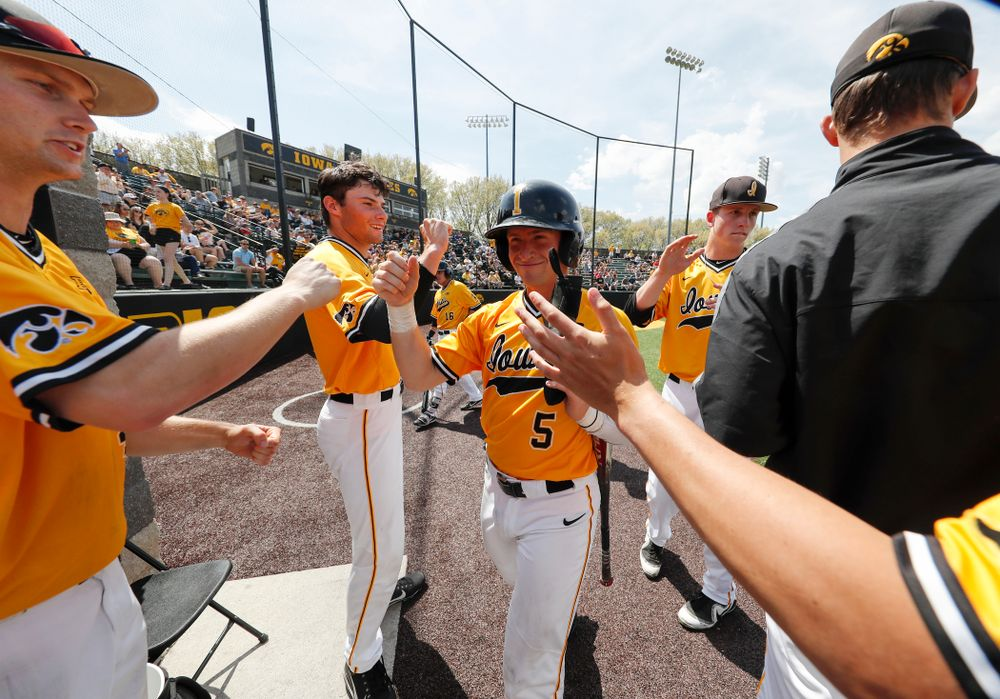 Iowa Hawkeyes catcher Tyler Cropley (5) high fives teammates after scoring against the Oklahoma State Cowboys Sunday, May 6, 2018 at Duane Banks Field. (Brian Ray/hawkeyesports.com)