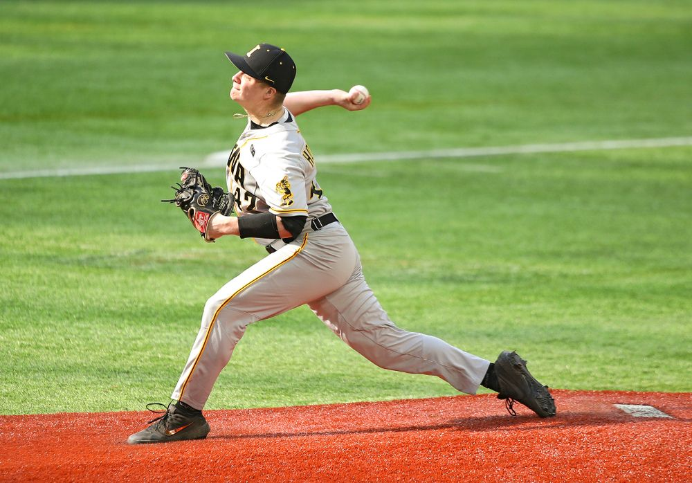 Iowa Hawkeyes pitcher Trace Hoffman (42) delivers to the plate during the third inning of their CambriaCollegeClassic game at U.S. Bank Stadium in Minneapolis, Minn. on Friday, February 28, 2020. (Stephen Mally/hawkeyesports.com)