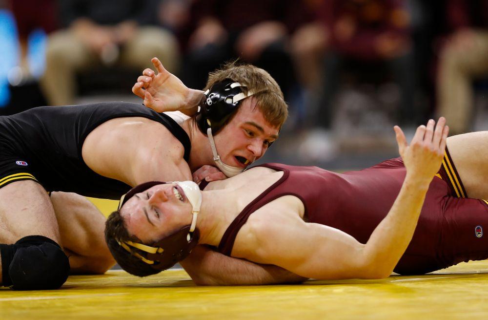 Iowa's Brandon Sorensen wrestles Minnesota's Ben Brancale at 149 pounds