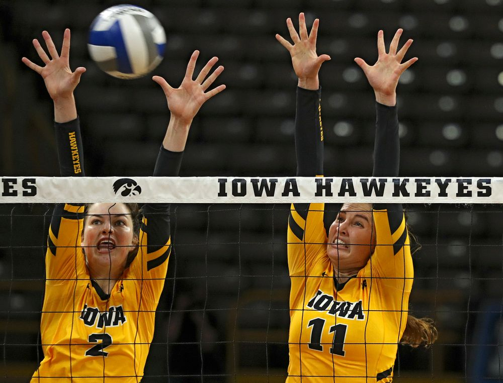 Iowa's Blythe Rients (11) gets a block as Courtney Buzzerio (2) looks on during their match at Carver-Hawkeye Arena in Iowa City on Sunday, Oct 20, 2019. (Stephen Mally/hawkeyesports.com)