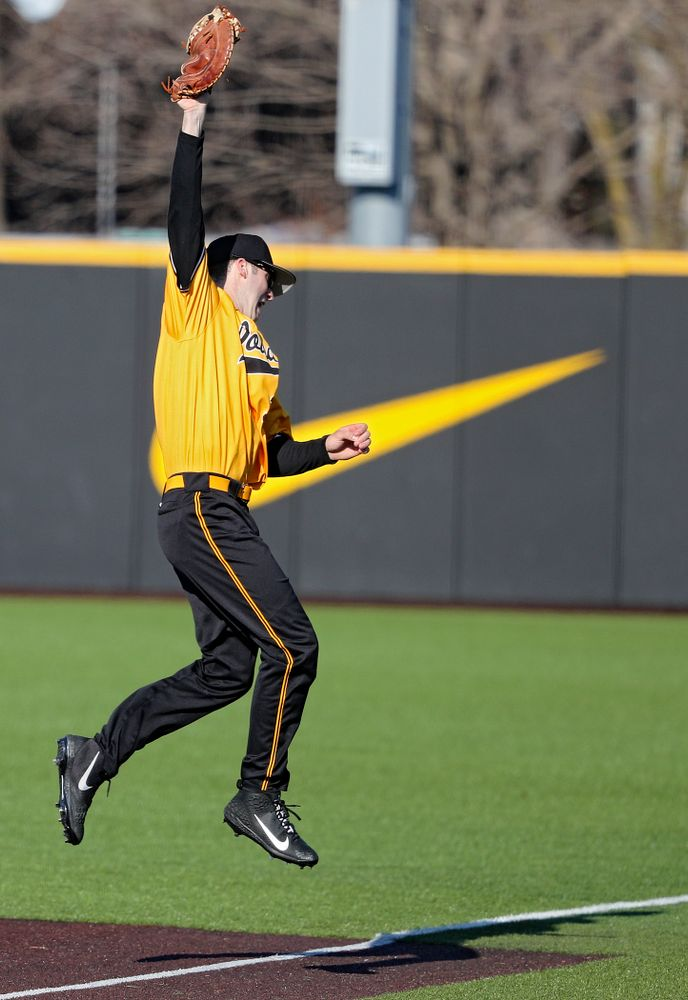 Iowa Hawkeyes first baseman Connor McCaffery (30) snags a line drive for an out during the fourth inning of their game at Duane Banks Field in Iowa City on Tuesday, Apr. 2, 2019. (Stephen Mally/hawkeyesports.com)
