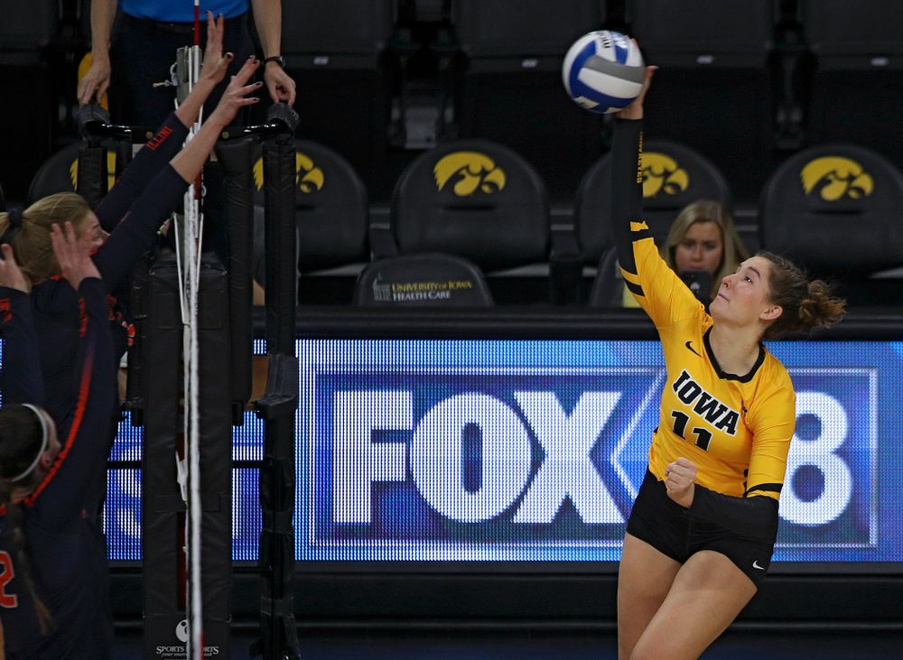 Iowa's Blythe Rients (11) gets a kill during the second set of their match against Illinois at Carver-Hawkeye Arena in Iowa City on Wednesday, Nov 6, 2019. (Stephen Mally/hawkeyesports.com)