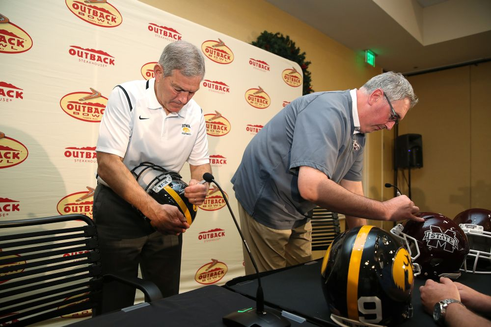 Iowa Hawkeyes head coach Kirk Ferentz and Mississippi State head coach Joe Moorhead sign autographs during the Outback Bowl coach's press conference Saturday, December 29, 2018 in Tampa, FL. (Brian Ray/hawkeyesports.com)