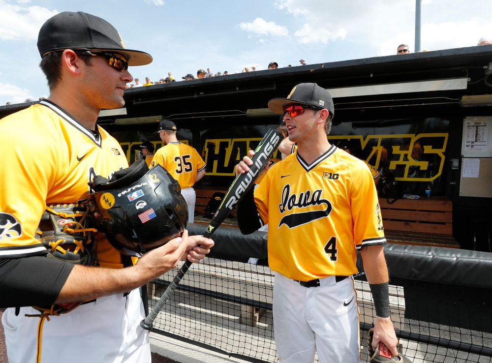 Iowa Hawkeyes infielder Mitchell Boe (4) and infielder Kyle Crowl (23) against the Oklahoma State Cowboys Sunday, May 6, 2018 at Duane Banks Field. (Brian Ray/hawkeyesports.com)