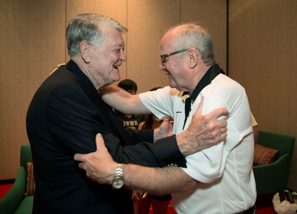 Former Hawkeye Football Head Coach Hayden Fry hugs long time athletic trainer John Streif before a panel discussion with his former quarterbacks during Fry Fest Friday, Aug. 29, 2014 in Coralville.  (Brian Ray/hawkeyesports.com)