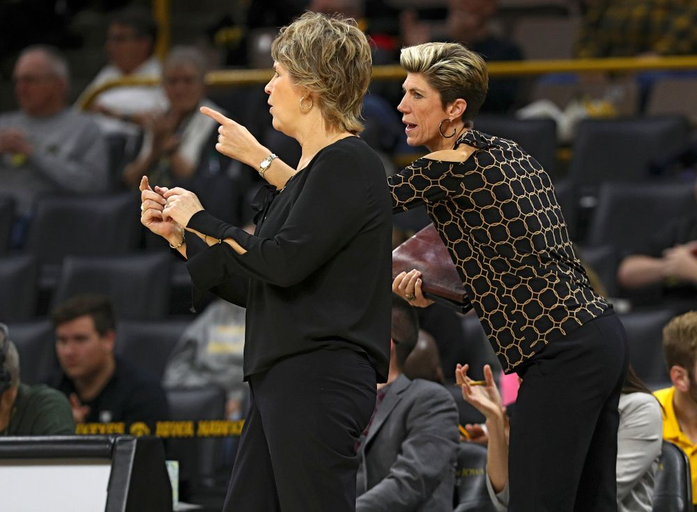 Iowa associate head coach Jan Jensen (right) talks with head coach Lisa Bluder during the third quarter of their overtime win against Princeton at Carver-Hawkeye Arena in Iowa City on Wednesday, Nov 20, 2019. (Stephen Mally/hawkeyesports.com)