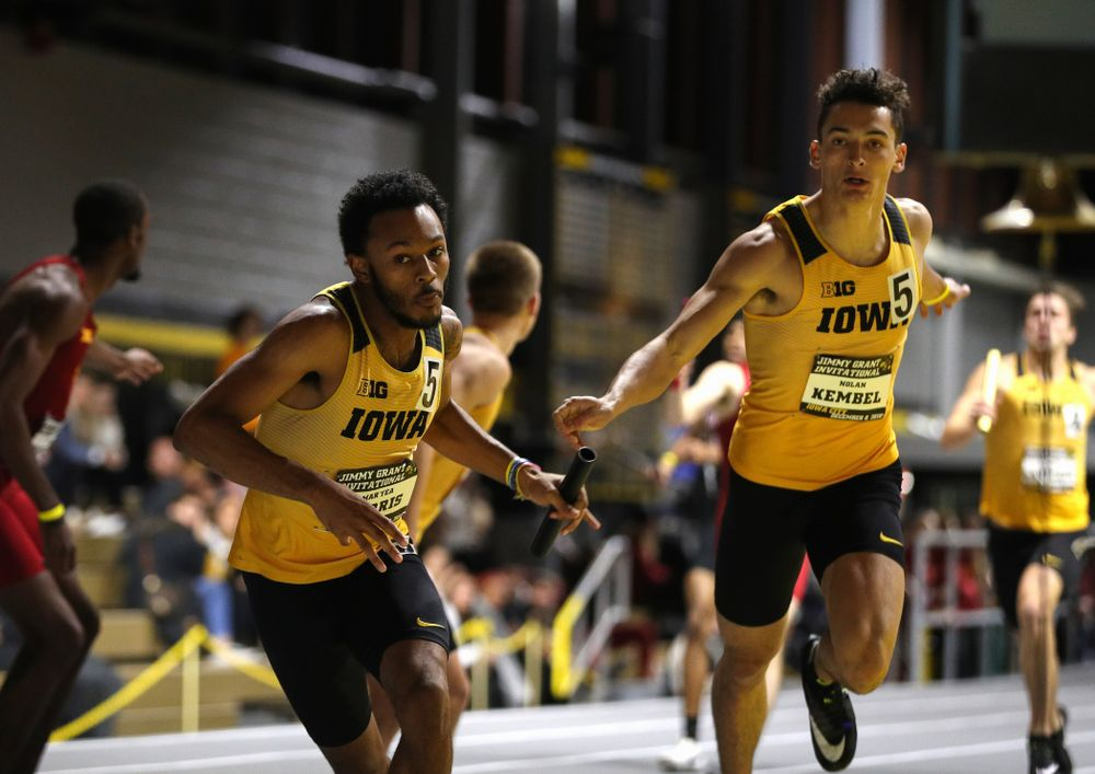 Iowa's Mar'Yea Harris takes the baton from Nolan Kembel during the 4x400 meter relay during the Jimmy Grant Invitational Saturday, December 8, 2018 at the Recreation Building. (Brian Ray/hawkeyesports.com)