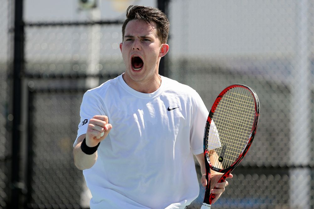 Iowa's Jonas Larson celebrates a point during his match against Michigan at the Hawkeye Tennis and Recreation Complex in Iowa City on Sunday, Apr. 21, 2019. (Stephen Mally/hawkeyesports.com)