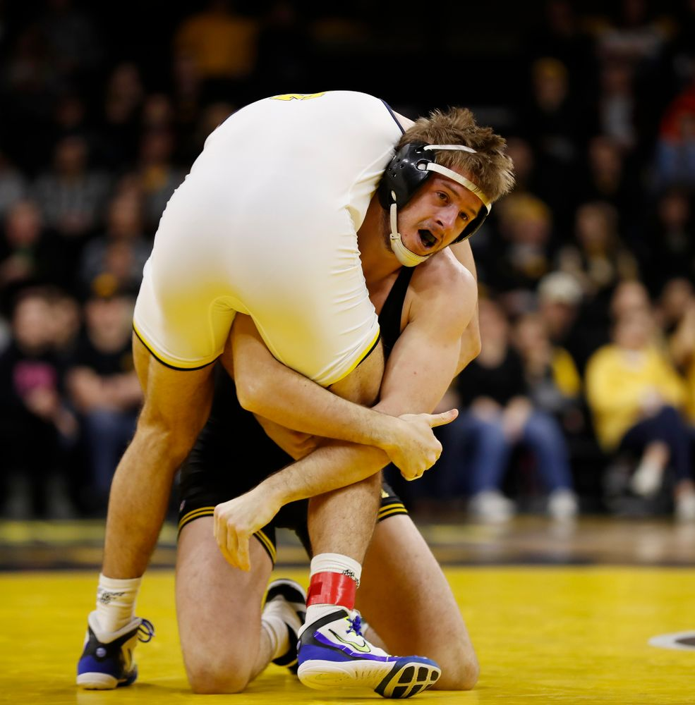 Iowa's Mitch Bowman against Michigan's Domenic Abounader at 184 pounds