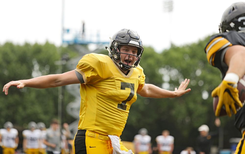 Iowa Hawkeyes quarterback Spencer Petras (7) celebrates with tight end Nate Wieting (39) after throwing a touchdown pass during Fall Camp Practice No. 11 at the Hansen Football Performance Center in Iowa City on Wednesday, Aug 14, 2019. (Stephen Mally/hawkeyesports.com)