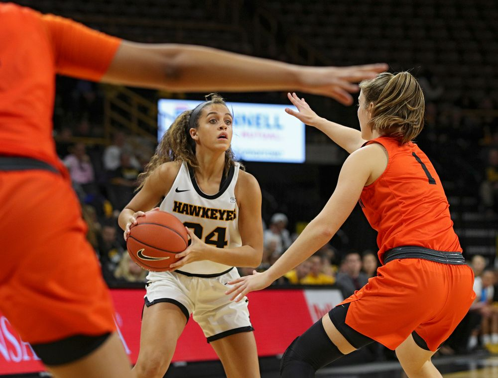 Iowa guard Gabbie Marshall (24) looks to pass during the first quarter of their overtime win against Princeton at Carver-Hawkeye Arena in Iowa City on Wednesday, Nov 20, 2019. (Stephen Mally/hawkeyesports.com)