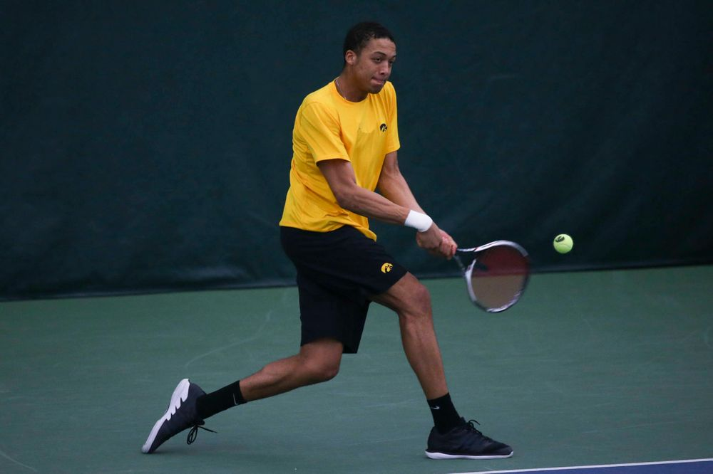 Iowa's Oliver Okonkwo at a tennis match vs Drake  Friday, March 8, 2019 at the Hawkeye Tennis and Recreation Complex. (Lily Smith/hawkeyesports.com)