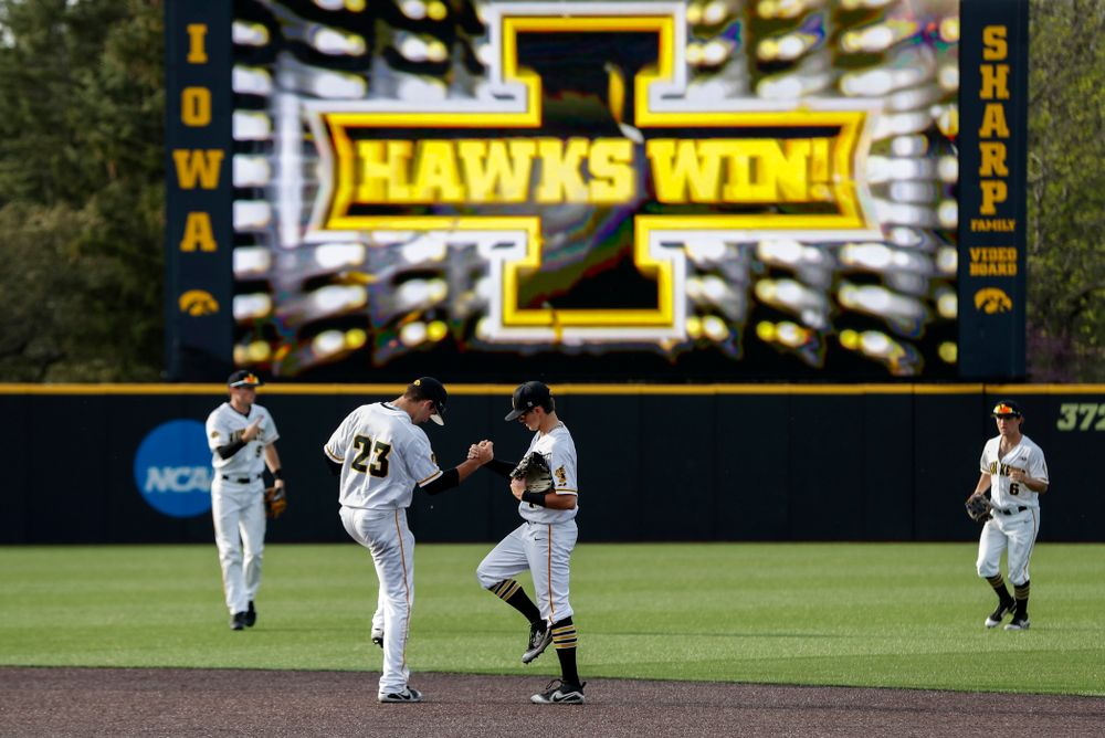 Iowa Hawkeyes infielder Kyle Crowl (23) and infielder Mitchell Boe (4) against the Oklahoma State Cowboys Saturday, May 5, 2018 at Duane Banks Field. (Brian Ray/hawkeyesports.com)