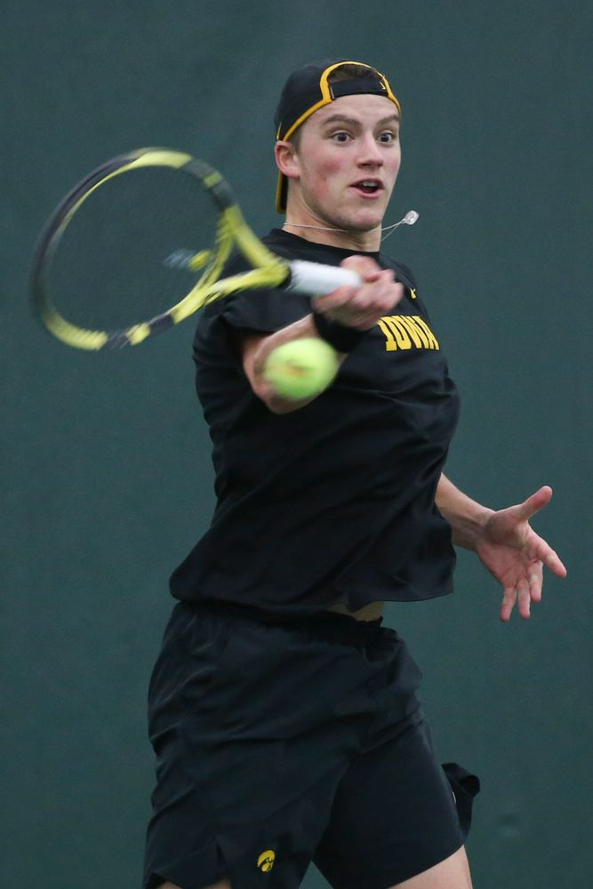 Iowa's Joe Tyler returns a hit during the Iowa men's tennis meet vs VCU  on Saturday, February 29, 2020 at the Hawkeye Tennis and Recreation Complex. (Lily Smith/hawkeyesports.com)