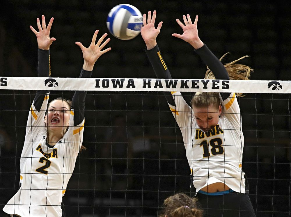 Iowa's Courtney Buzzerio (2) and Hannah Clayton (18) block a shot during their Big Ten/Pac-12 Challenge match at Carver-Hawkeye Arena in Iowa City on Saturday, Sep 7, 2019. (Stephen Mally/hawkeyesports.com)
