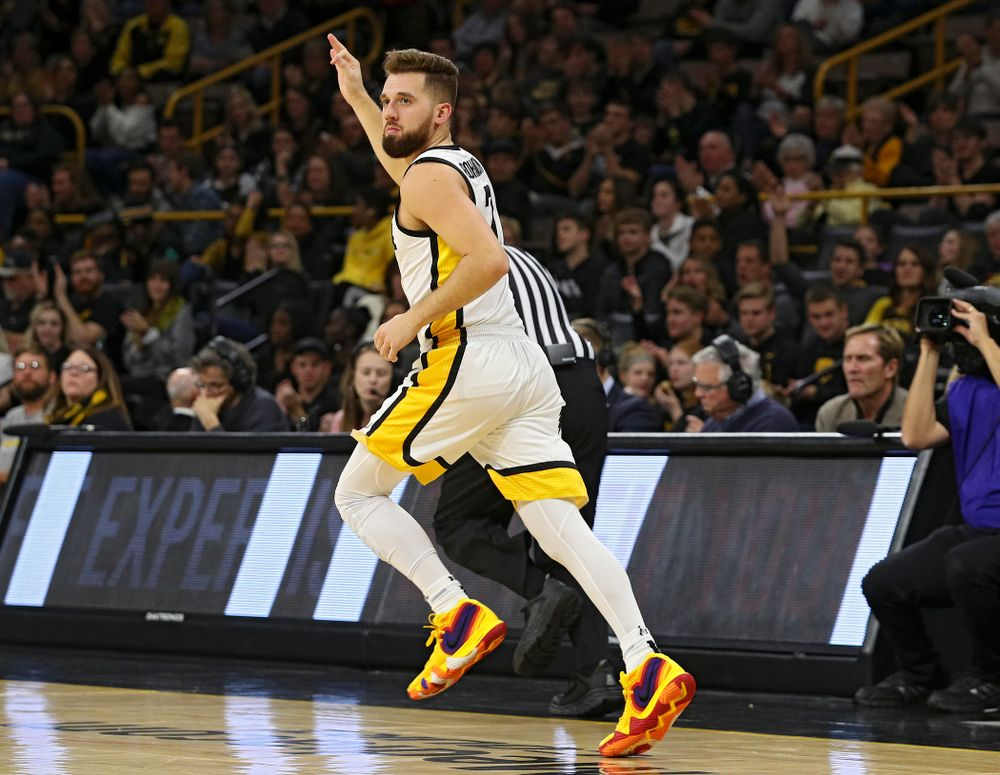 Iowa Hawkeyes guard Jordan Bohannon (3) holds up three fingers as he runs down the court after making a 3-pointer during the first half of their game at Carver-Hawkeye Arena in Iowa City on Friday, Nov 8, 2019. (Stephen Mally/hawkeyesports.com)