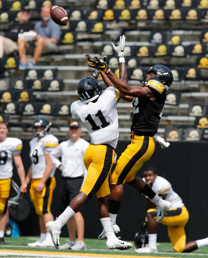 Iowa Hawkeyes defensive back Michael Ojemudia (11) and wide receiver Brandon Smith (12) during Kids Day Saturday, August 11, 2018 at Kinnick Stadium. (Brian Ray/hawkeyesports.com)