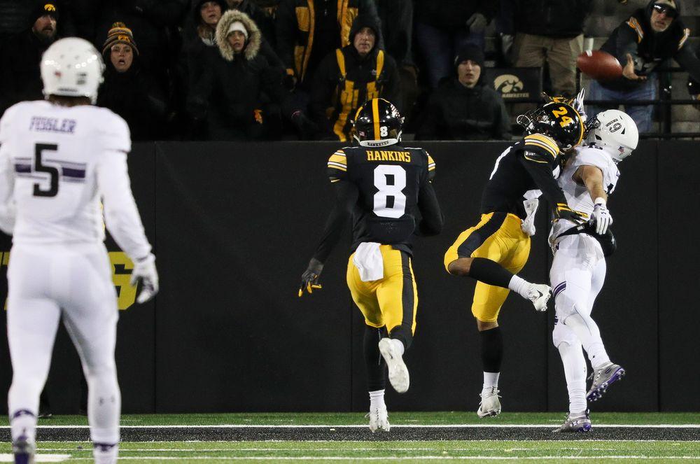 Iowa Hawkeyes defensive back Amani Hooker (27) breaks up a pass during a game against Northwestern at Kinnick Stadium on November 10, 2018. (Tork Mason/hawkeyesports.com)