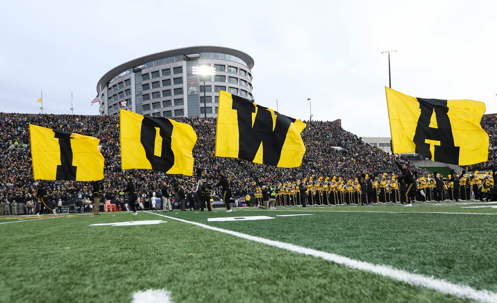 The Iowa Hawkeyes football team swarms the field before a game against Northwestern at Kinnick Stadium on November 10, 2018. (Tork Mason/hawkeyesports.com)