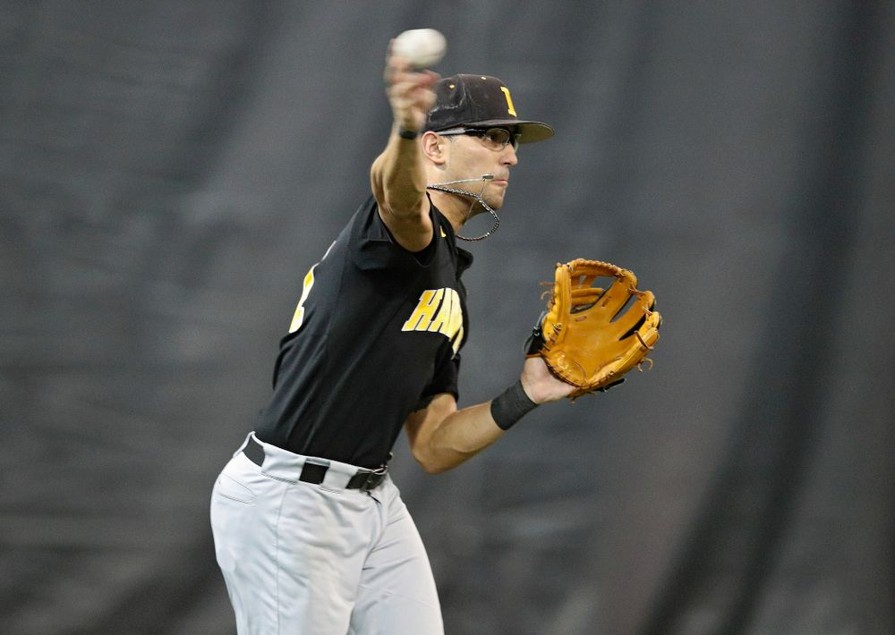Iowa Hawkeyes infielder Matthew Sosa (31) throws to first base during practice at the Hansen Football Performance Center in Iowa City on Friday, January 24, 2020. (Stephen Mally/hawkeyesports.com)