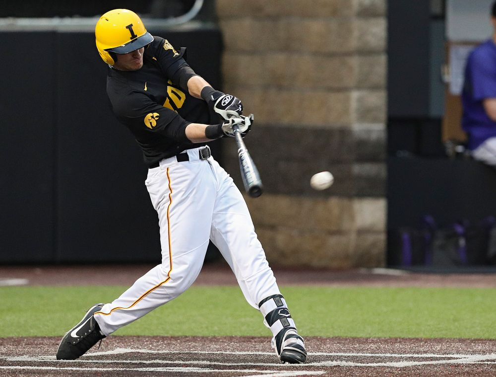 Iowa Hawkeyes shortstop Tanner Wetrich (16) gets a hit and two runs score after an error during the fourth inning of their game against Western Illinois at Duane Banks Field in Iowa City on Wednesday, May. 1, 2019. (Stephen Mally/hawkeyesports.com)
