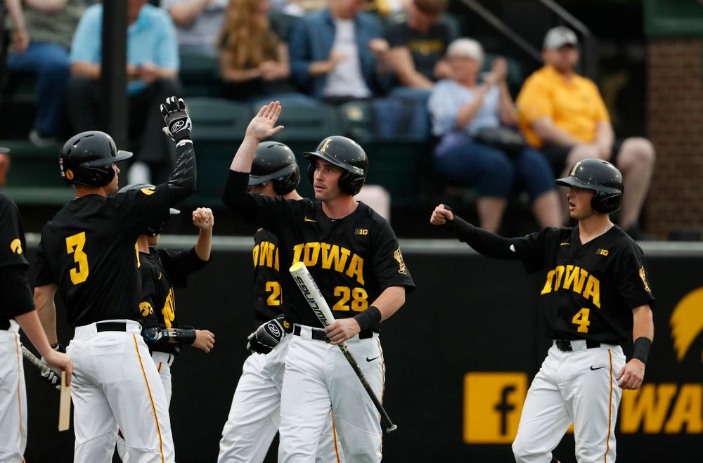 Iowa Hawkeyes infielder Chris Whelan (28) and infielder Mitchell Boe (4) score against the Penn State Nittany Lions Friday, May 18, 2018 at Duane Banks Field. (Brian Ray/hawkeyesports.com)