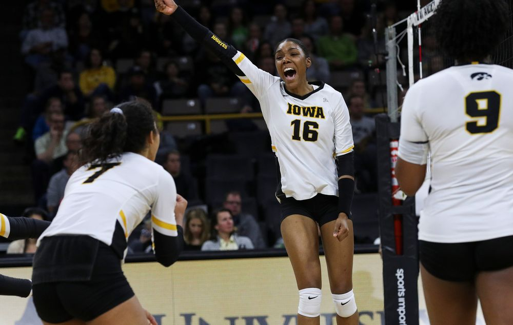 Iowa Hawkeyes outside hitter Taylor Louis (16) celebrates after winning a point during a match against Penn State at Carver-Hawkeye Arena on November 3, 2018. (Tork Mason/hawkeyesports.com)