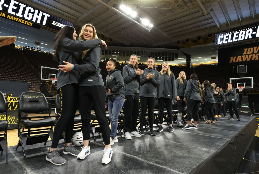 Iowa Hawkeyes forward Megan Gustafson (10) hugs forward Hannah Stewart (21) after finding out her jersey will be retired at a ceremony next season during the teamÕs Celebr-Eight event Wednesday, April 24, 2019 at Carver-Hawkeye Arena. (Brian Ray/hawkeyesports.com)