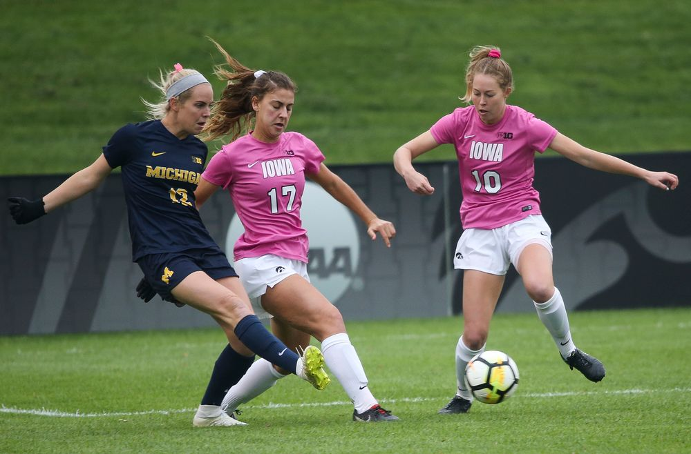 Iowa Hawkeyes defender Hannah Drkulec (17) and Iowa Hawkeyes midfielder Natalie Winters (10) make a tackle during a game against Michigan at the Iowa Soccer Complex on October 14, 2018. (Tork Mason/hawkeyesports.com)