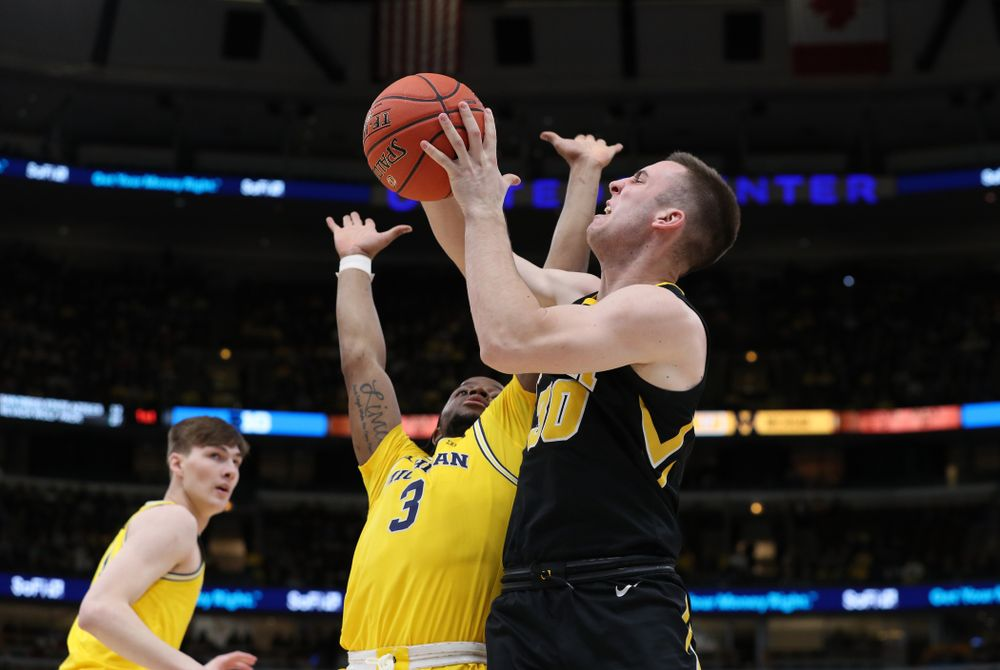Iowa Hawkeyes guard Connor McCaffery (30) against the Michigan Wolverines in the 2019 Big Ten Men's Basketball Tournament Friday, March 15, 2019 at the United Center in Chicago. (Brian Ray/hawkeyesports.com)