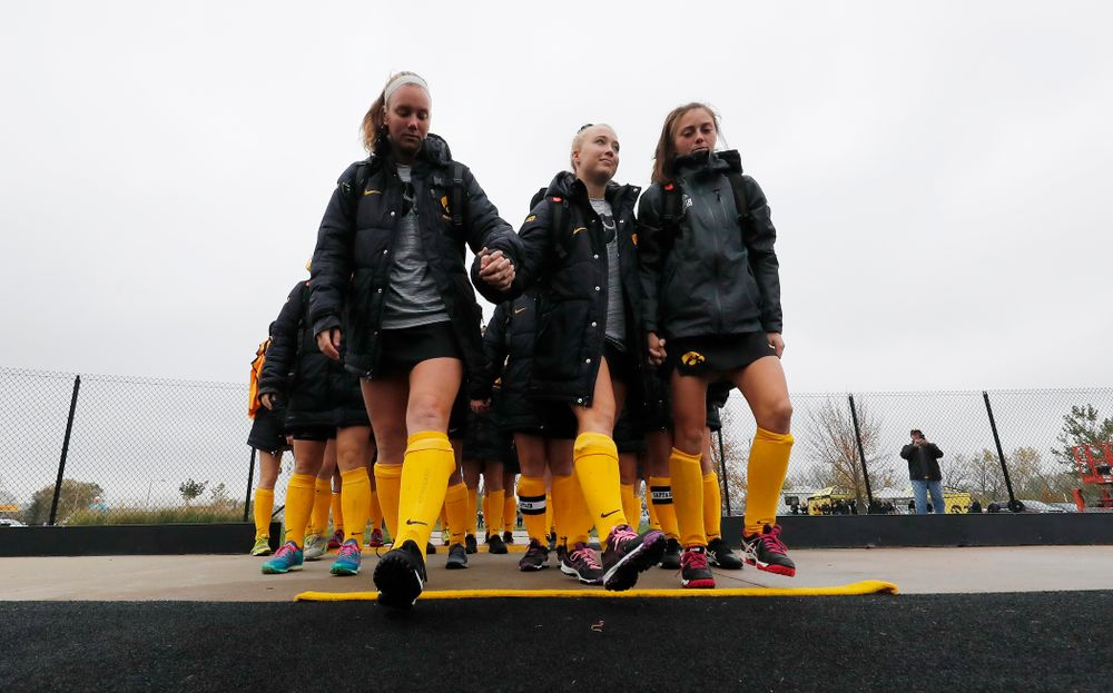The Iowa Hawkeyes seniors cross the line Sunday, October 14, 2018 before their game against Maryland. (Brian Ray/hawkeyesports.com)