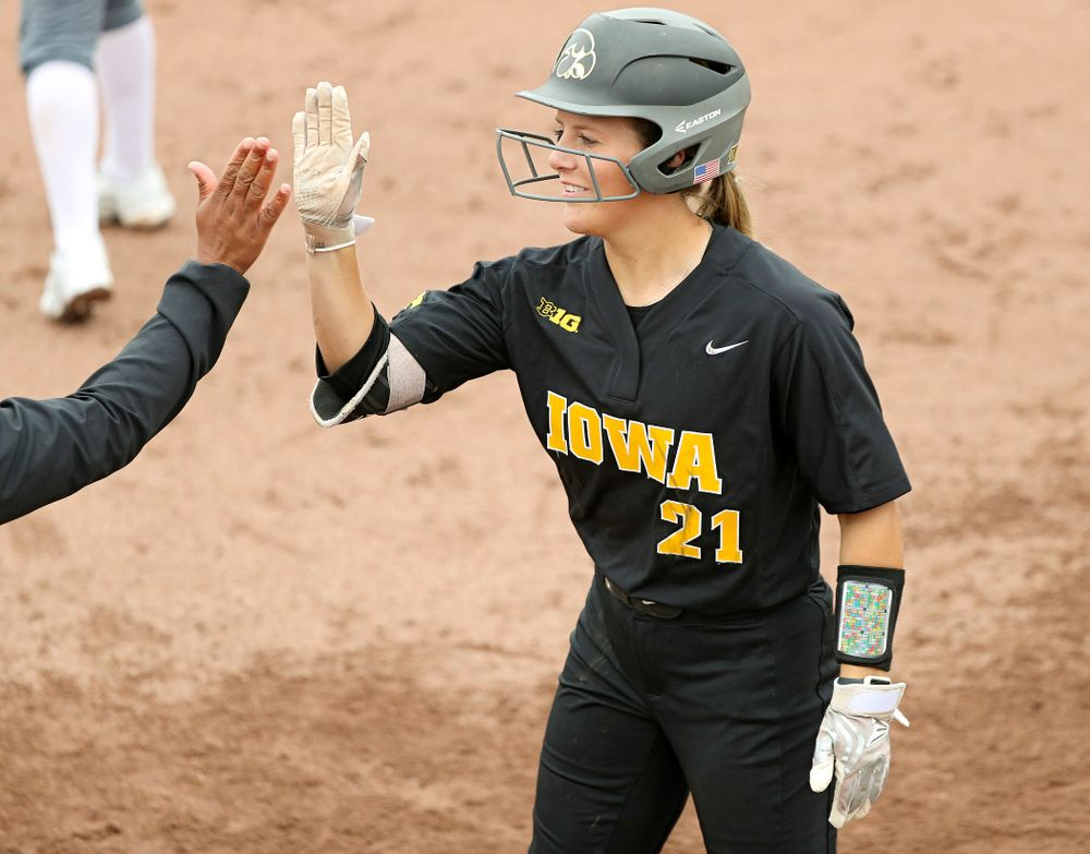 Iowa outfielder Havyn Monteer (21) gets a high-five after a bunt single during the fifth inning of their game against Iowa Softball vs Indian Hills Community College at Pearl Field in Iowa City on Sunday, Oct 6, 2019. (Stephen Mally/hawkeyesports.com)
