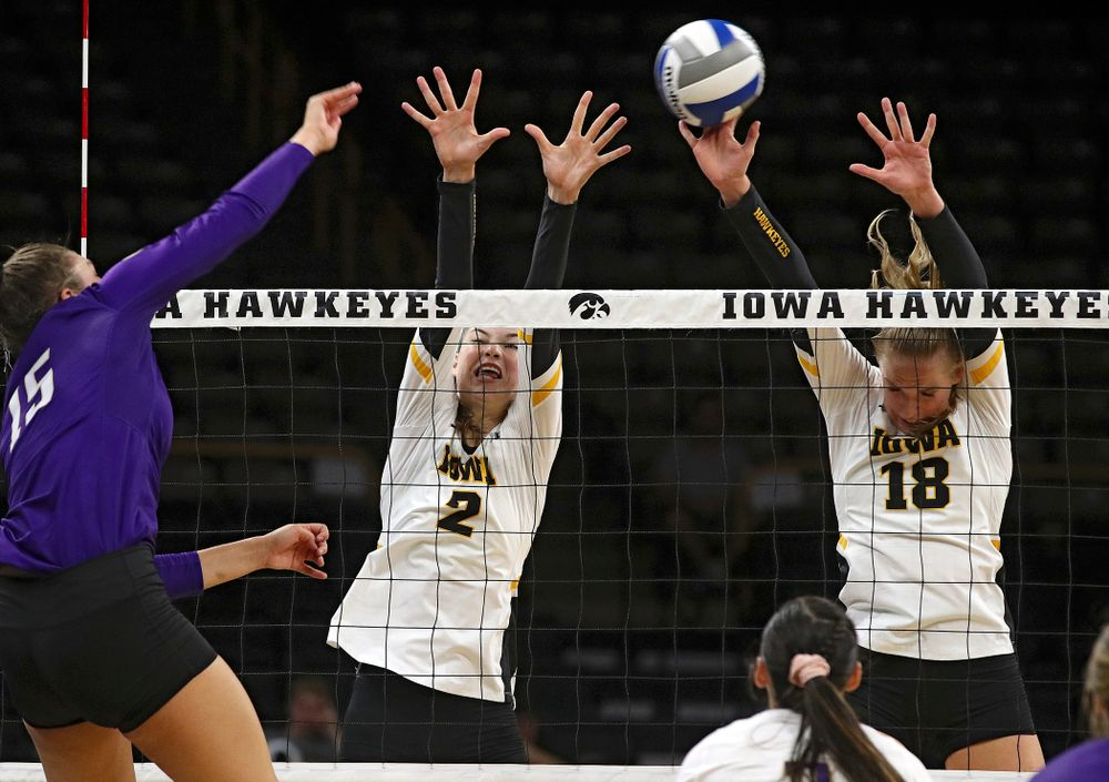 Iowa's Hannah Clayton (18) gets her hands on a shot as Courtney Buzzerio (2) also jumps during their Big Ten/Pac-12 Challenge match at Carver-Hawkeye Arena in Iowa City on Saturday, Sep 7, 2019. (Stephen Mally/hawkeyesports.com)