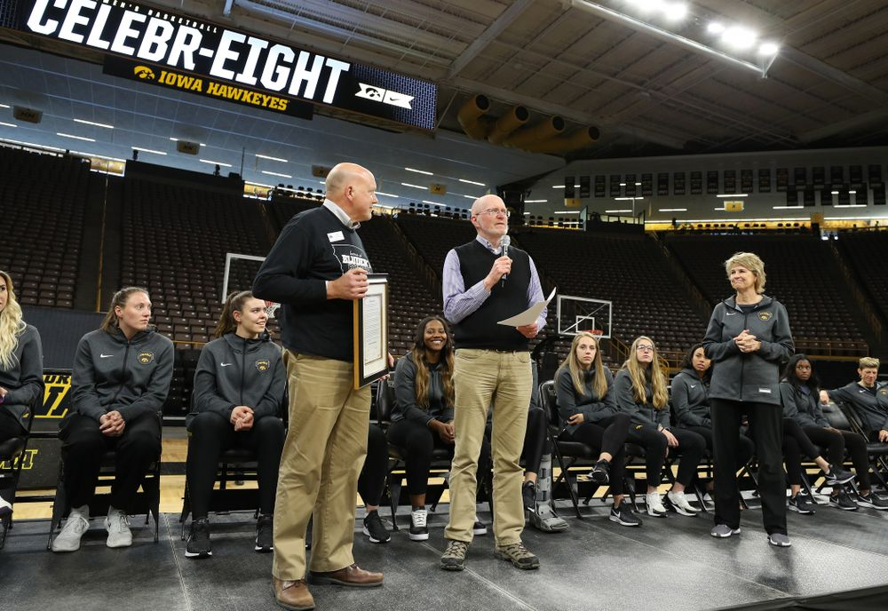 Iowa City Mayor Jim Throgmorton and Coralville Mayor John Lundell present Iowa Hawkeyes head coach Lisa Bluder with a joint proclamation designating April 24, 2019 as Iowa WomenÕs Basketball Day during the teamÕs Celebr-Eight event Wednesday, April 24, 2019 at Carver-Hawkeye Arena. (Brian Ray/hawkeyesports.com)