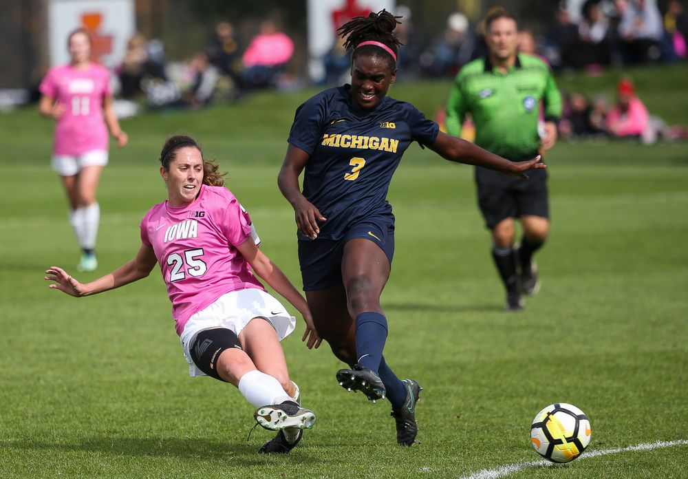 Iowa Hawkeyes midfielder Josie Durr (25) makes a tackle during a game against Michigan at the Iowa Soccer Complex on October 14, 2018. (Tork Mason/hawkeyesports.com)