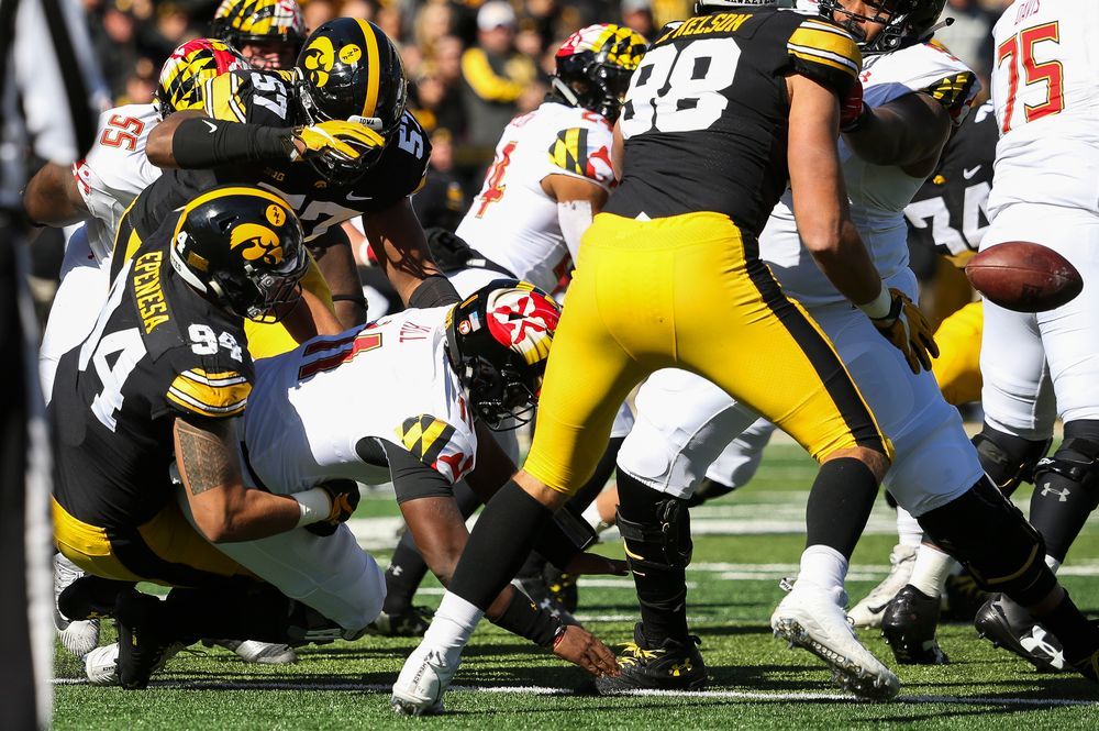 Iowa Hawkeyes defensive end A.J. Epenesa (94) and Iowa Hawkeyes defensive end Chauncey Golston (57) sack the quarterback during a game against Maryland at Kinnick Stadium on October 20, 2018. (Tork Mason/hawkeyesports.com)