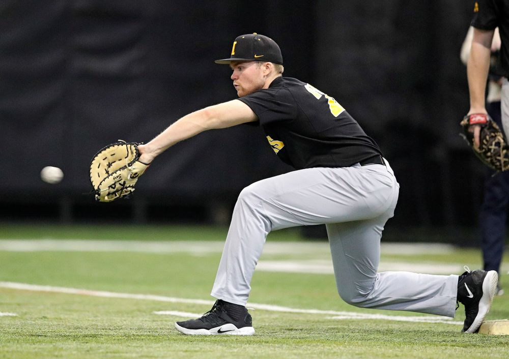 Iowa Hawkeyes first baseman Tanner Padgett (22) pulls in a throw during practice at the Hansen Football Performance Center in Iowa City on Friday, January 24, 2020. (Stephen Mally/hawkeyesports.com)
