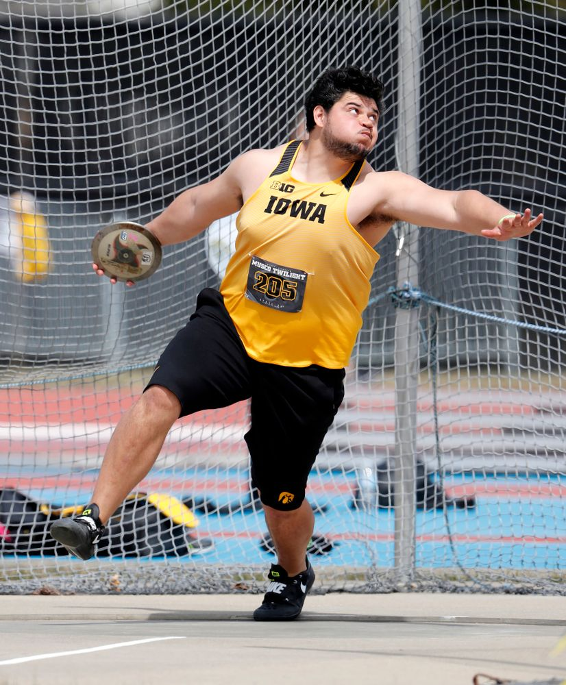 Iowa's Reno Tuufuli competes in the discus during the 2018 MUSCO Twilight Invitational  Thursday, April 12, 2018 at the Cretzmeyer Track. (B