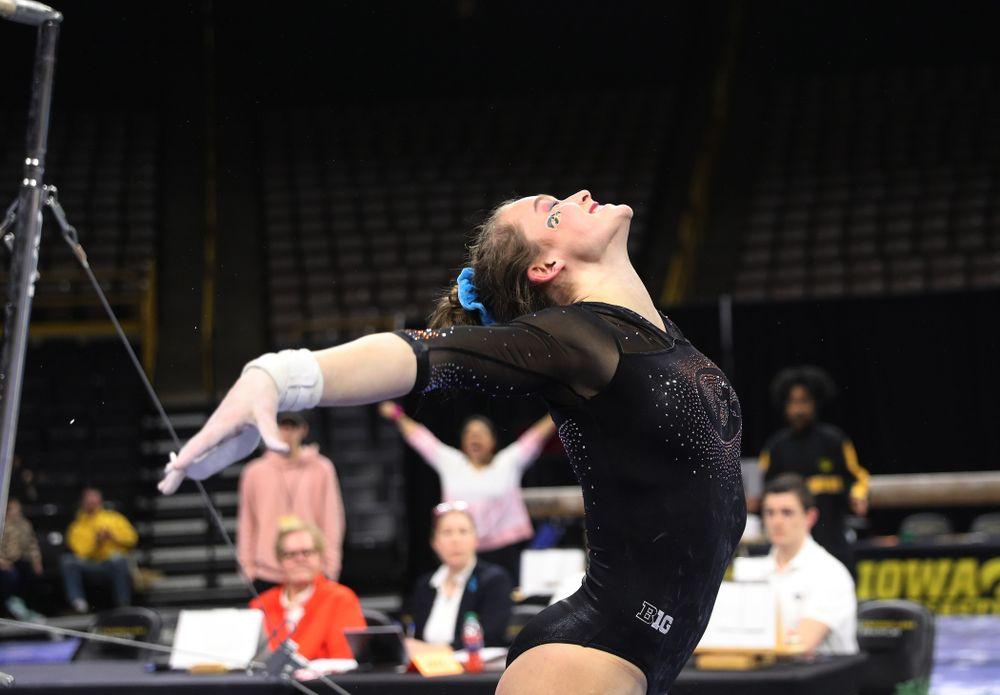 Iowa's Mackenzie Vance competes on the bars against Michigan Friday, February 14, 2020 at Carver-Hawkeye Arena. (Brian Ray/hawkeyesports.com)